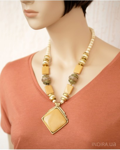 Bone and resin necklace with a pendant